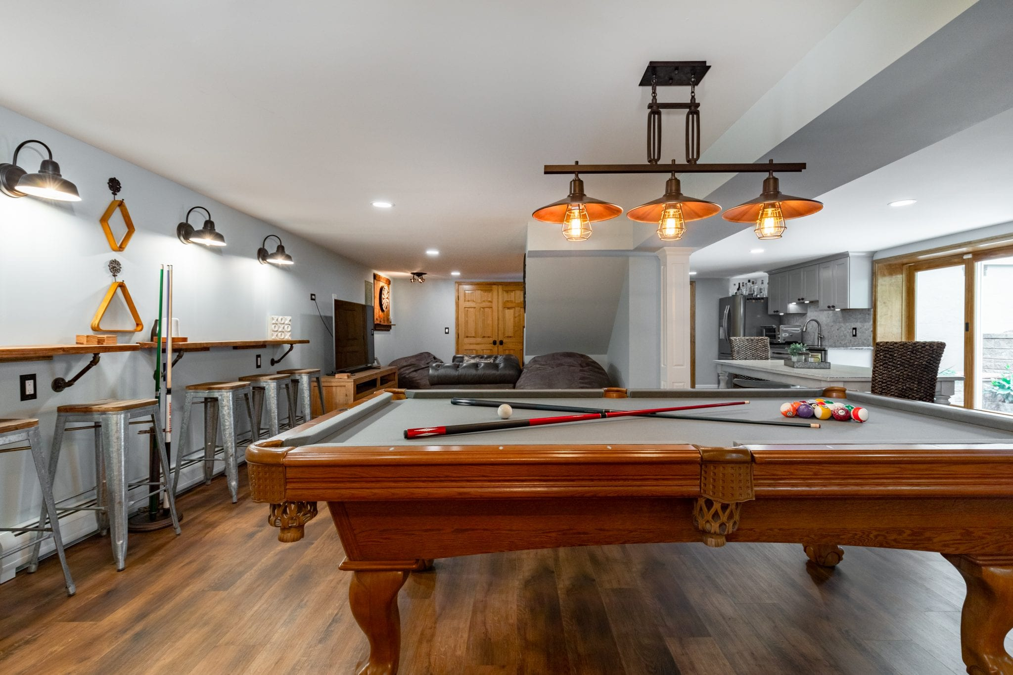 living room space with a pool table of a detached basement