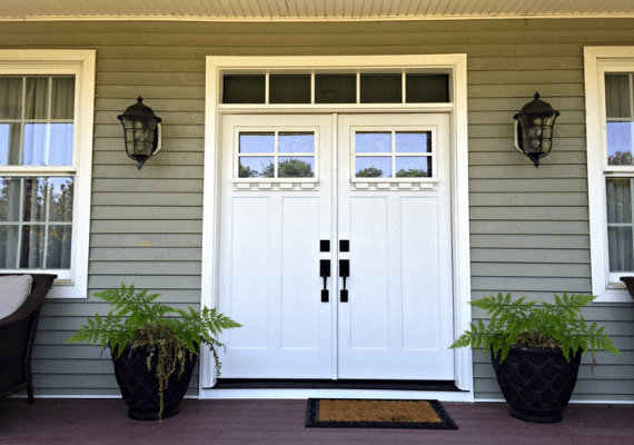 White Front Door with Two Black Flanking Sconces