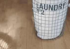 Laundry Basket on wood floors