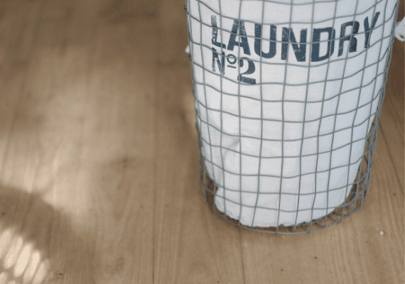 Laundry Basket on wood floors